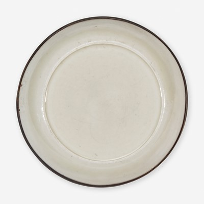 """Lot 1 - A small Chinese Dingyao incised """"Lotus"""" dish 定窑刻划莲花小盘"""