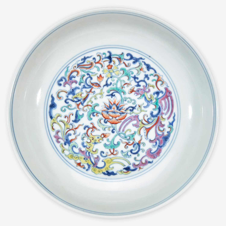 "Lot 26 - A Chinese doucai-decorated porccelain ""Phoenix"" dish 斗彩凤纹盘"