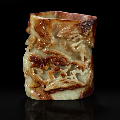 Lot 137 - A Chinese carved russet and celadon jade brush holder 青玉笔筒