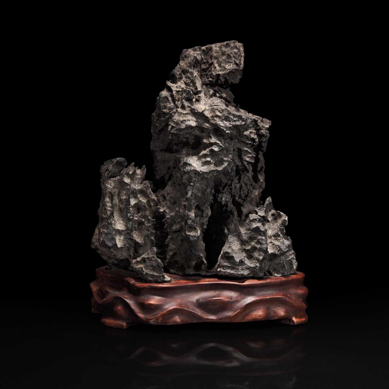 Lot 47 - A Chinese tall grey Lingbi-style scholars stone 灵璧石一件