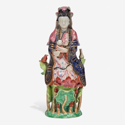 Lot 19 - A Chinese export porcelain famille rose-decorated figure of Guanyin and child 粉彩出口瓷观音送子