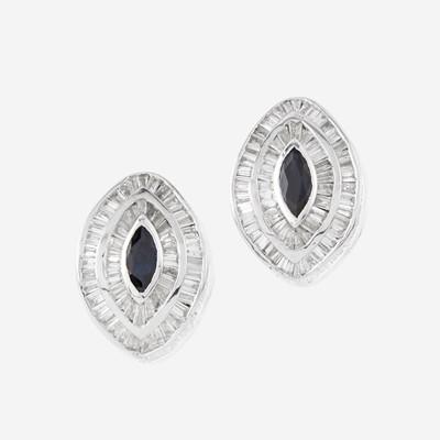 Lot 64 - A pair of rhodium plated fourteen karat gold, sapphire, and diamond earrings