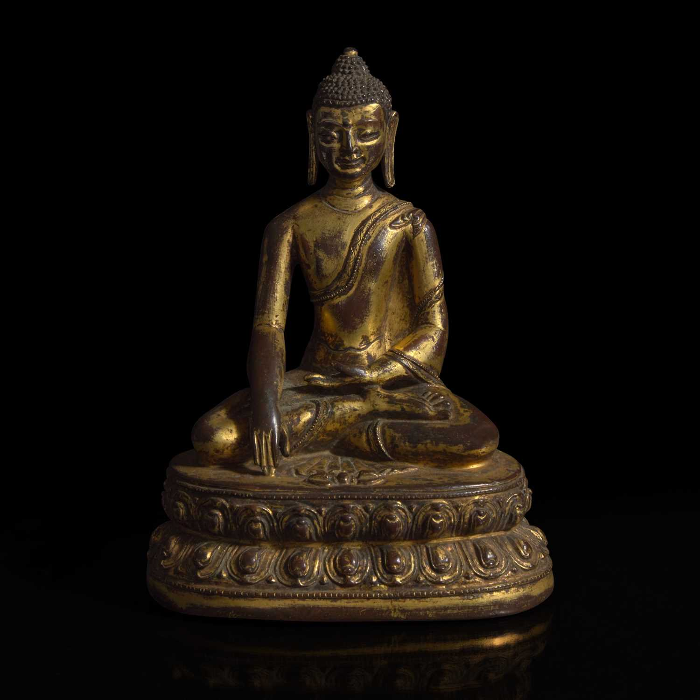 Lot 253 - A Himalayan gilt copper alloy figure of Buddha Akshobhya 喜马拉雅铜鎏金阿閦佛造像
