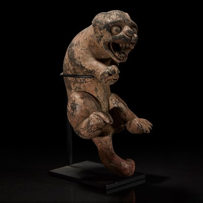 Lot 170 - A carved and painted wood figure of a rampant feline 木雕大猫