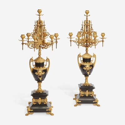 Lot 37 - A Pair of Napoleon III Gilt-Bronze and Black Marble Seven-Light Candelabra