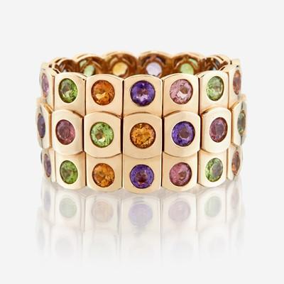 Lot 16 - An eighteen karat gold and gem-set bangle