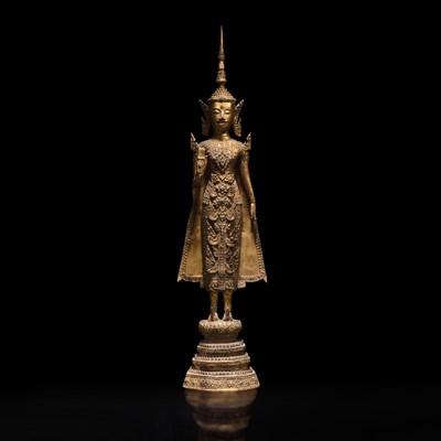 Lot 180 - A Thai gilt lacquered bronze standing Buddha 泰国漆金佛造像立像