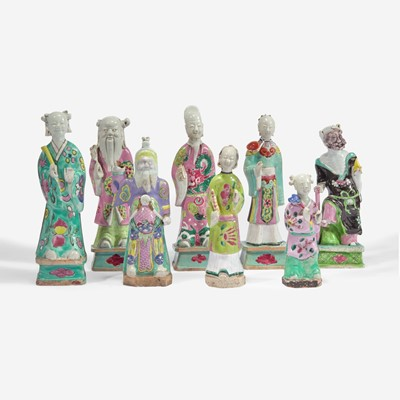 Lot 100 - An assembled group of eight Chinese enameled porcelain immortals 瓷塑八仙一组