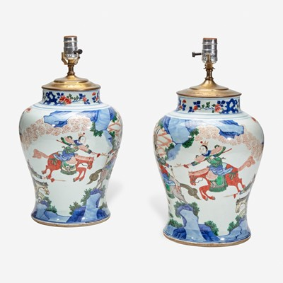Lot 102 - A pair of large Chinese wucai-decorated porcelain jars, mounted as lamps 五彩人物大罐改装台灯一对