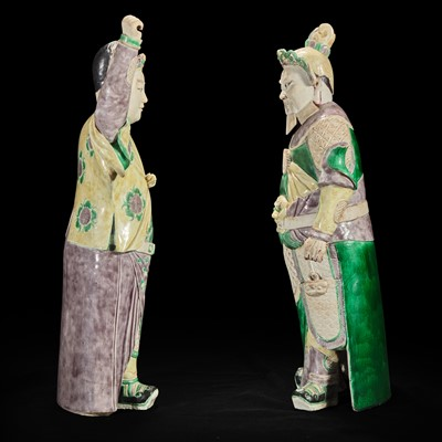 Lot 92 - An unusual pair of large Chinese famille-verte decorated porcelain guardians 五彩门神一对
