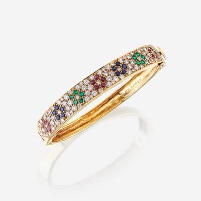 Lot 37 - An eighteen karat gold and gem-set bangle, Van Cleef & Arpels
