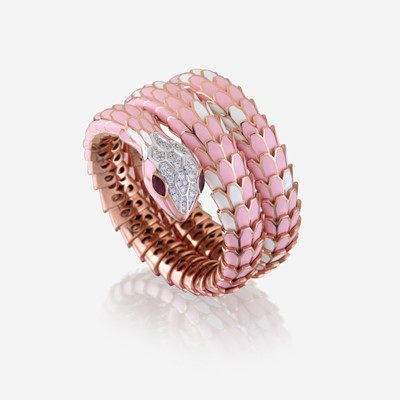 Lot 44 - An enamel, diamond, ruby, and eighteen karat rose gold plated sterling silver bangle
