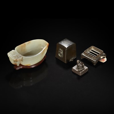 Lot 106 - A Chinese pale celadon jade archaistic libation cup and a bronze rabbit seal 玉匜与铜兔印章一组
