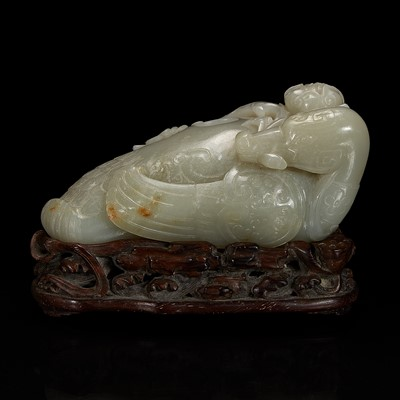 """Lot 123 - A Chinese celadon jade archaistic """"Duck"""" water coupe and carved wood stand 青玉鸭形水丞配木底座"""