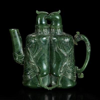 "Lot 127 - An unusual Chinese spinach jade archaistic ""Double-bird"" ewer 双天鸡碧玉壶"