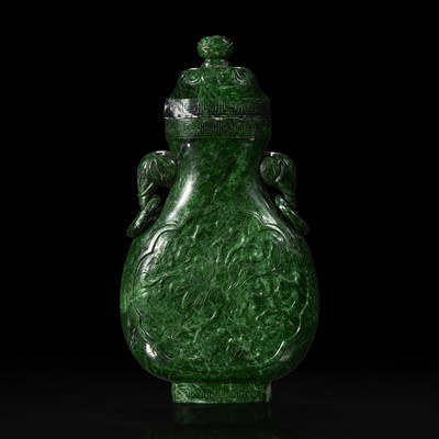 Lot 138 - A Chinese carved chloromelanite vase and cover 玉盖罐