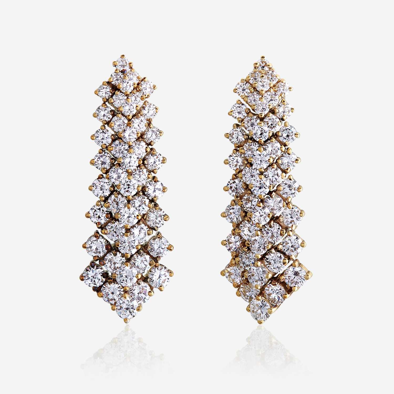 Lot 25 - A pair of diamond and eighteen karat gold earrings