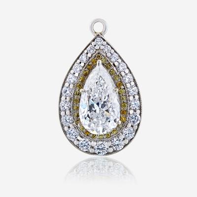 Lot 69 - A diamond, colored diamond, and ten karat white gold pendant
