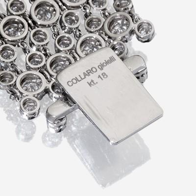 Lot 60 - An eighteen karat white gold and diamond bracelet