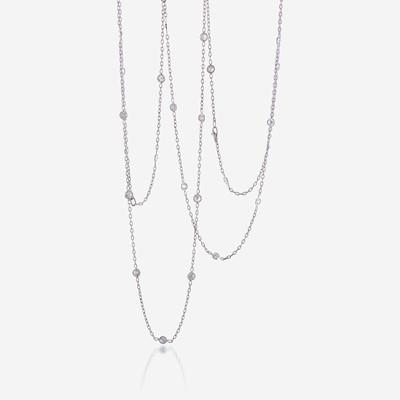 Lot 59 - A pair of eighteen karat gold and diamond chains