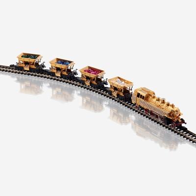 Lot 18 - An eighteen karat gold, diamond, and synthetic gemstone model train No. 12, Halberstadt