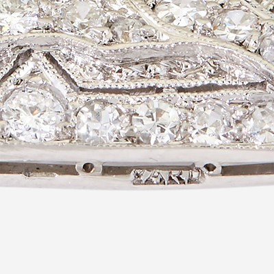 Lot 6 - A yellow diamond, diamond, zircon, and fourteen karat white gold pendant/brooch, Raymond Yard