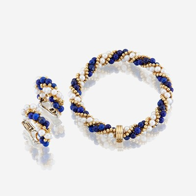 Lot 29 - A lapis lazuli, cultured pearl, and eighteen karat gold bracelet with similar ear clips