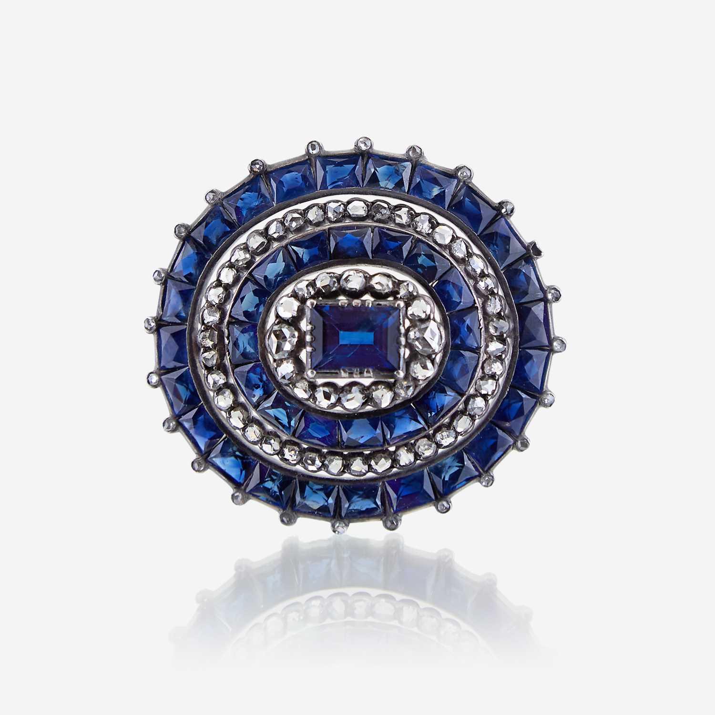 Lot 4 - A sapphire, diamond, and silver topped eighteen karat gold brooch