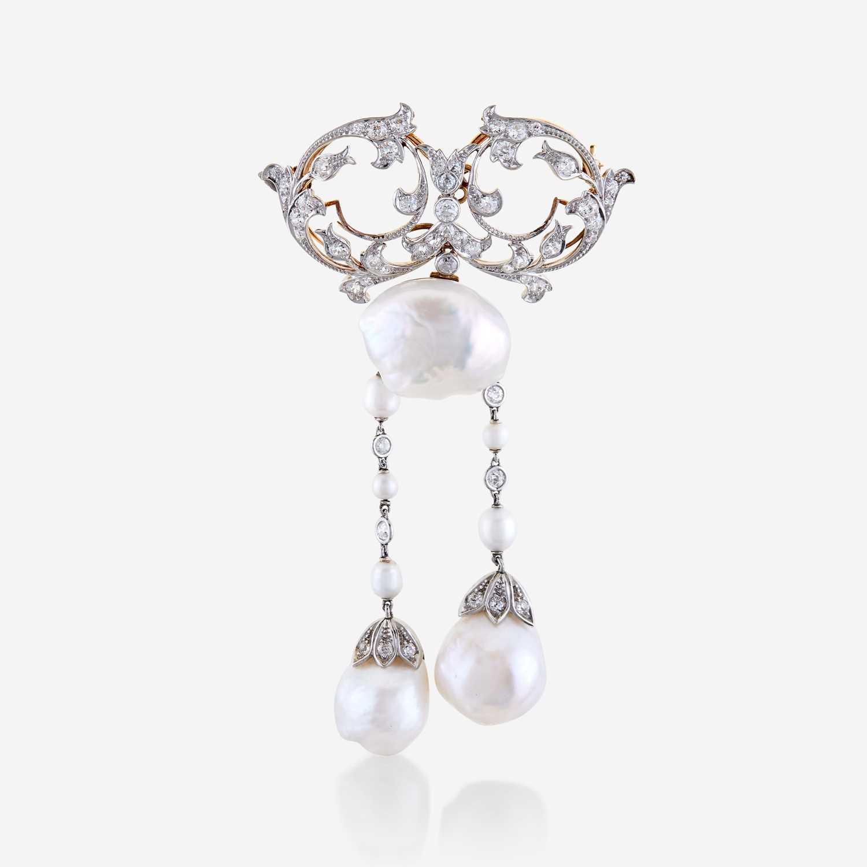 Lot 63 - A natural pearl, diamond, eighteen karat gold, and platinum brooch