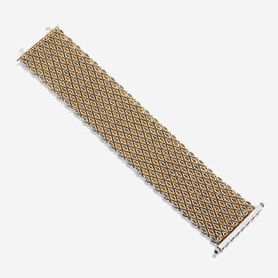 Lot 42 - A bicolor fourteen karat gold and diamond bracelet