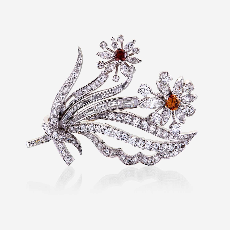 Lot 47 - A diamond, colored diamond, and platinum brooch