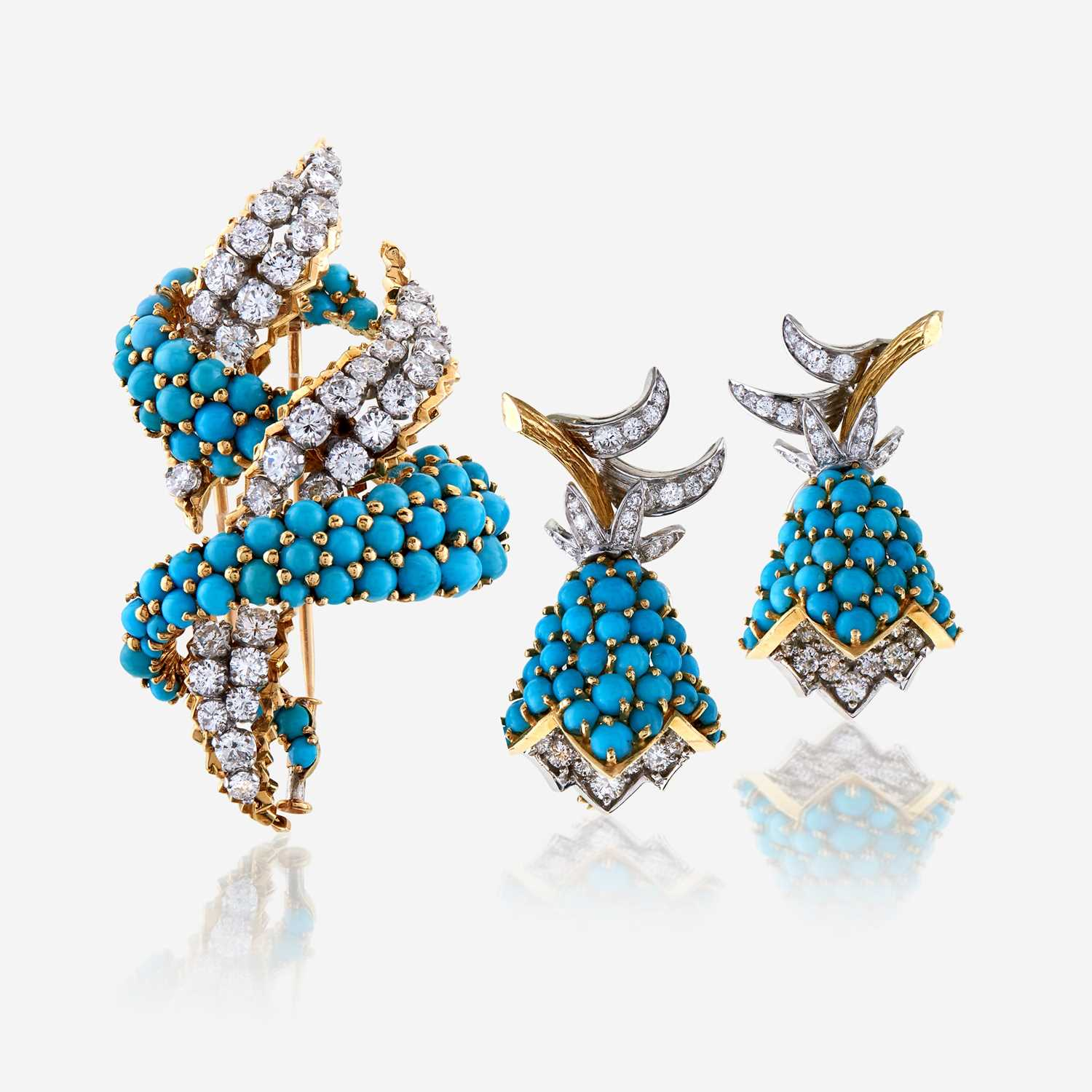 Lot 21 - A diamond, turquoise, and eighteen karat gold brooch with matching ear clips, Cartier