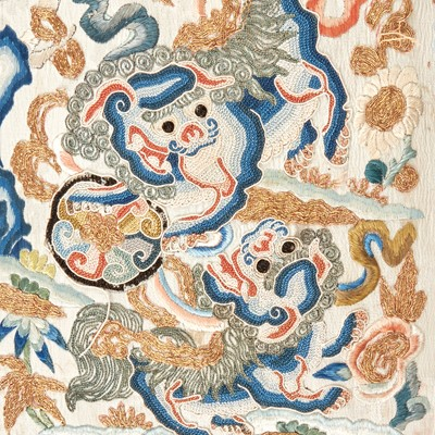"""Lot 68 - A Chinese embroidered silk """"Buddhist Lions"""" panel, mounted as a pillow 刺绣太狮少狮画片嵌枕头"""
