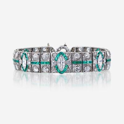 Lot 66 - An Art Deco diamond, emerald, and platinum bracelet