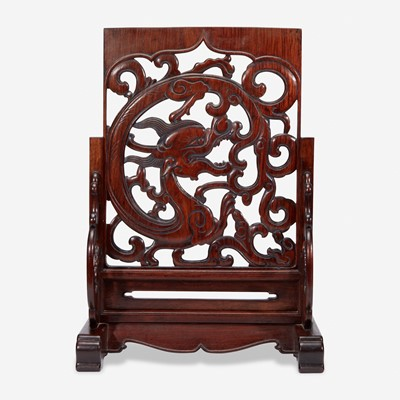 """Lot 42 - A Chinese carved and pierced huanghuali """"dragon"""" panel, in later hardwood stand 黄花梨镂雕龙纹木板 后配底座"""