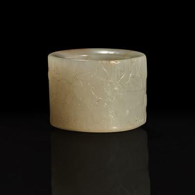 Lot 126 - A large pale celadon and russet jade archer ring with Imperial poem and hunting scene 乾隆御题诗狩猎图玉扳指