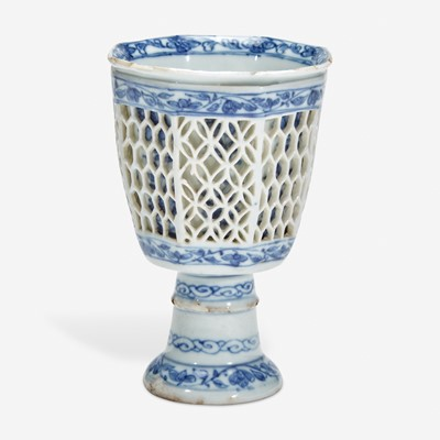 Lot 7 - A Chinese blue and white porcelain reticulated stemmed cup 青花镂空高足杯