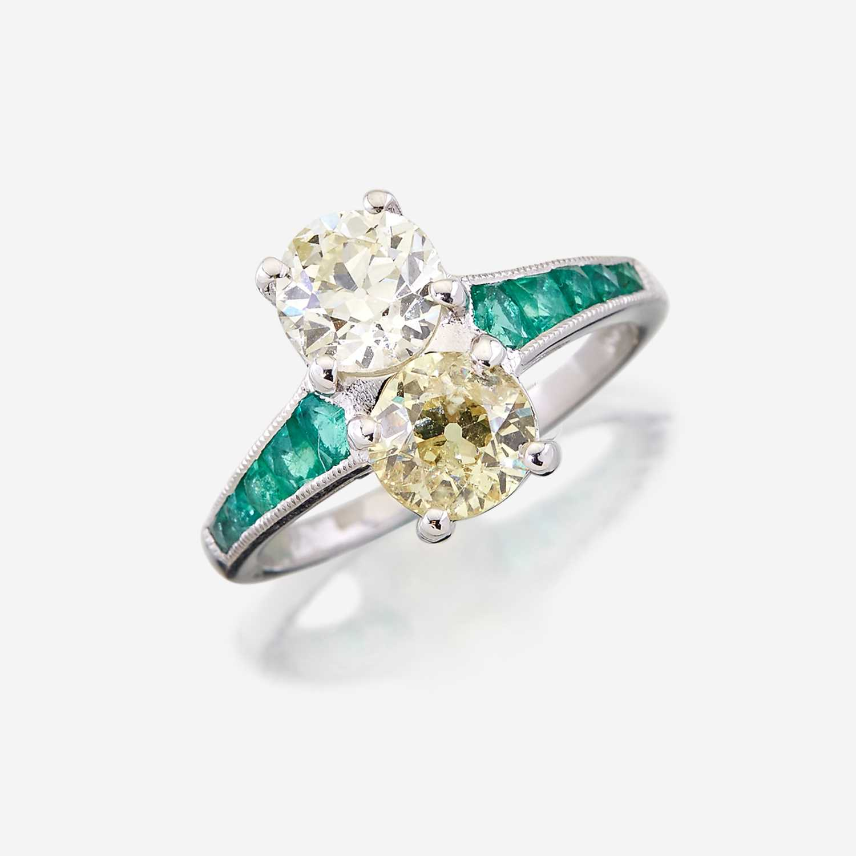Lot 7 - A fancy yellow diamond, diamond, emerald, and platinum ring