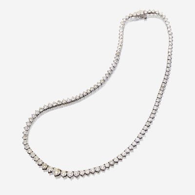 Lot 51 - A diamond and eighteen karat white gold rivière necklace