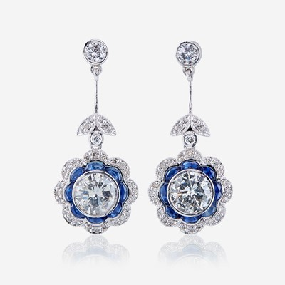 Lot 46 - A pair of diamond, sapphire, and platinum earrings