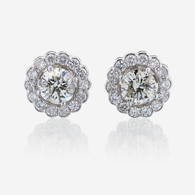 Lot 58 - A pair of diamond and eighteen karat white gold earrings