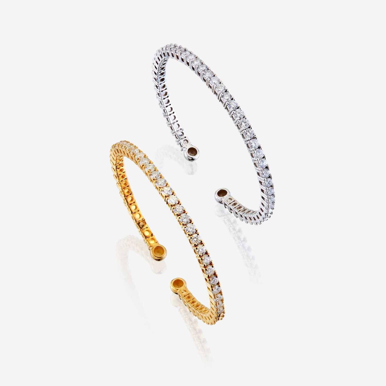 Lot 43 - A pair of diamond and fourteen karat gold bangles