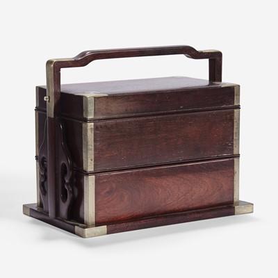 Lot 50 - A Chinese stacking hardwood two-tier box, possibly zitan 双层提梁木盒 或紫檀