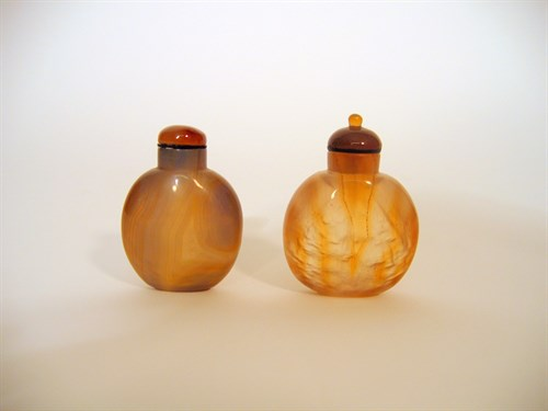 Lot 8 - Two Chinese 'smoky' agate snuff bottles