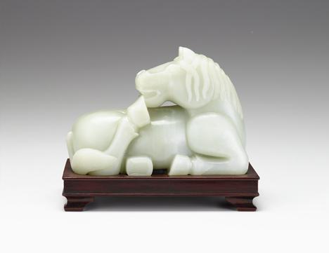 Lot 67 - Large Chinese light celadon jade horse