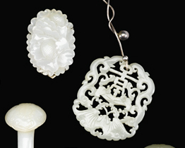 Lot 58 - Two Chinese white jade pendants, and four jadeite items