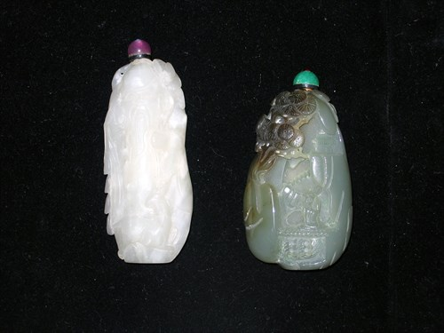 Lot 28 - Two Chinese white and dark celadon snuff bottles