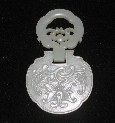 Lot 38 - Chinese white/light celadon jade pendant, in export silver case