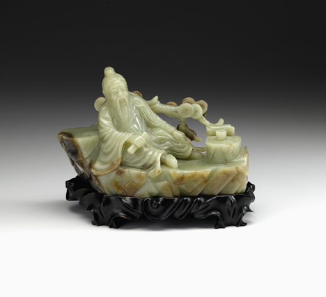 Lot 78 - Large Chinese celadon and brown jade figural grouping, on stand