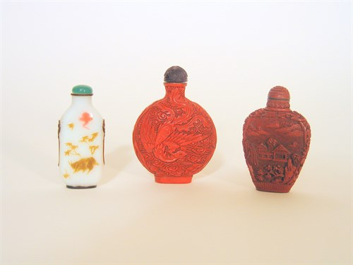 Lot 6 - Three Chinese snuff bottles, two cinnabar lacquer and one glass overlay